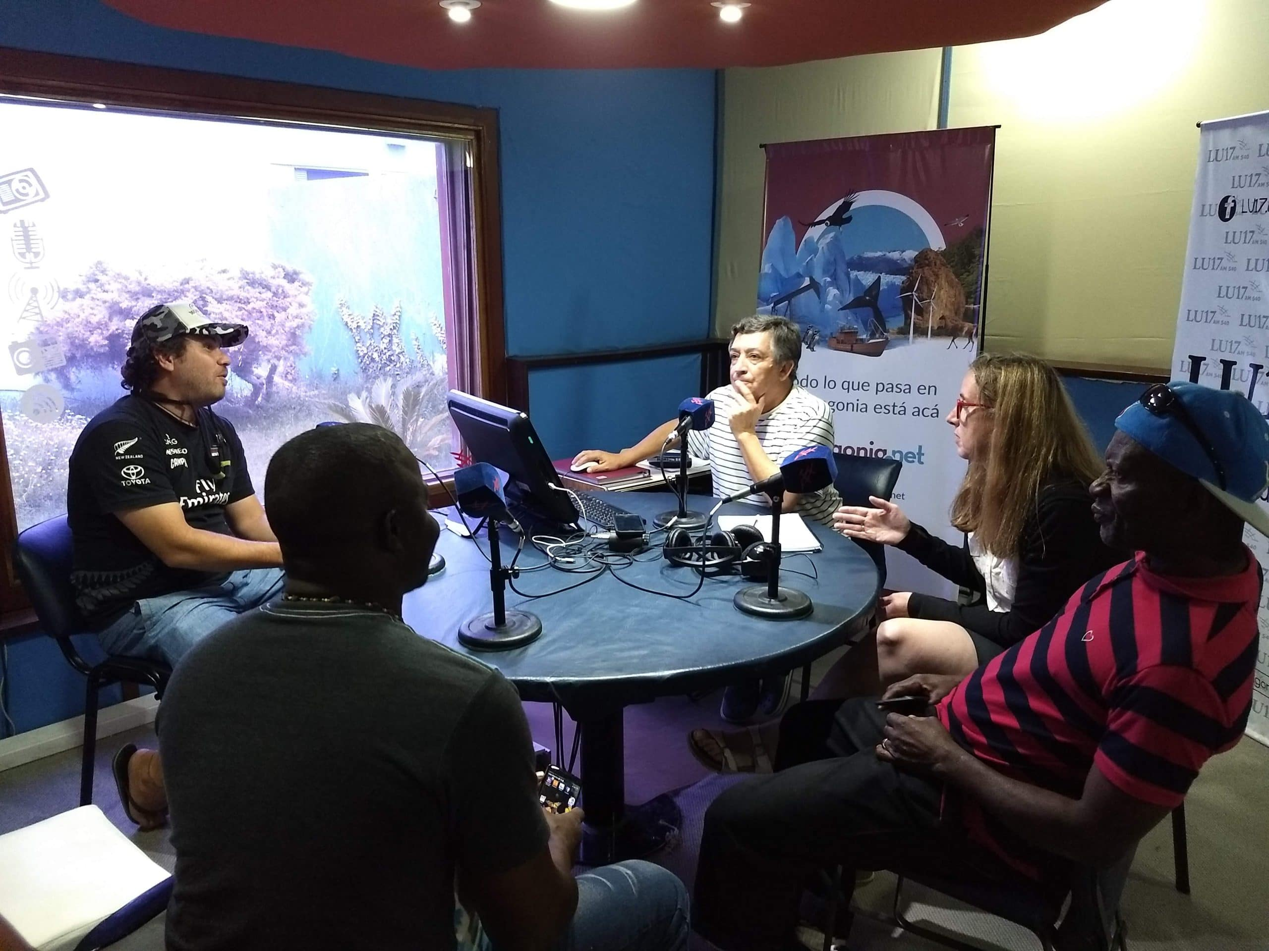 Lennox, Kirk and Carolina give a radio interview on a local station