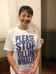 Green MP Caroline Lucas wearing 'Please Stop Whaling' t-shirt in support of a ban on whaling.