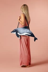Sun, sea, sand and an adorable Māui dolphin by your side!