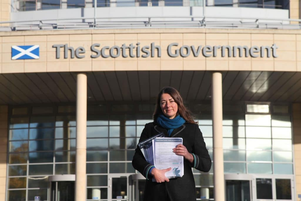 Sarah Dolman presenting our supporters responses at the Scottish Parliament.