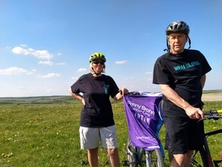 Martin and Judy cycled 2.6 miles a day