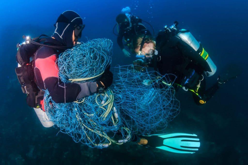 Retrieving netting underwater