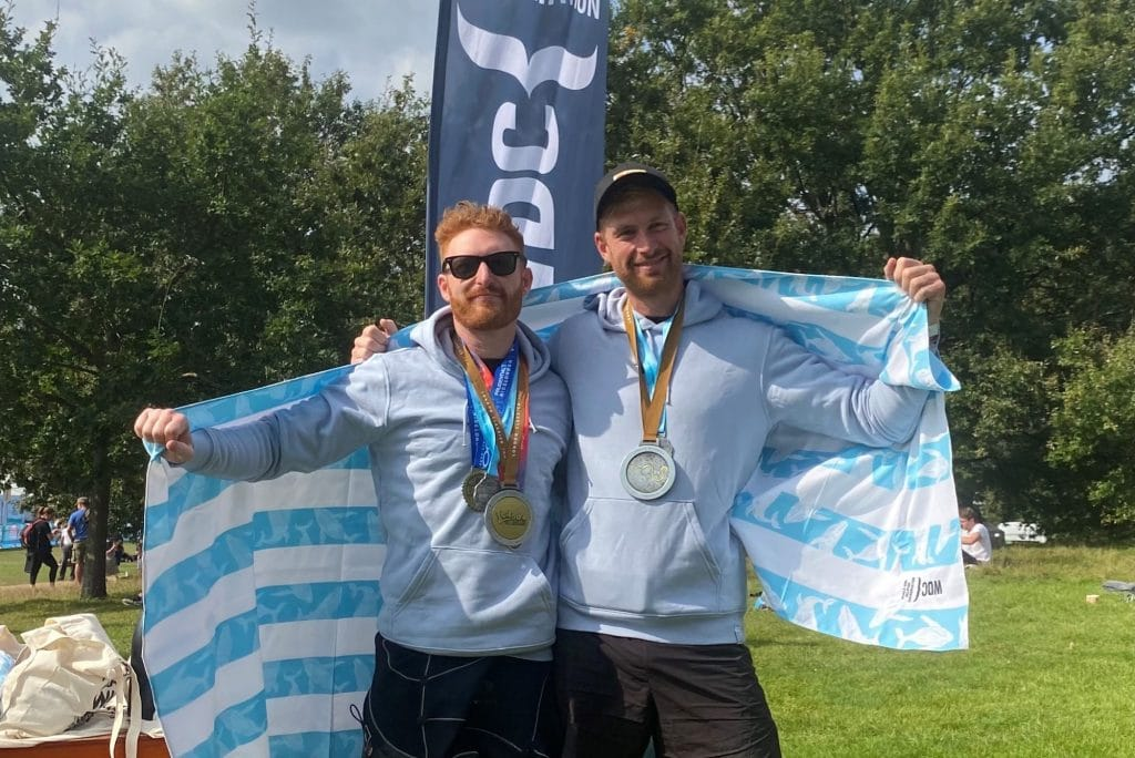 Adam and Laurence with medals