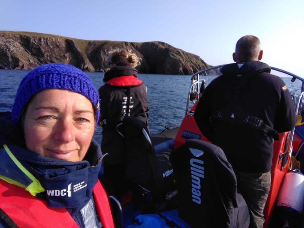 I'm the one in the middle of the photo, my colleague Sarah is in the foreground and our skipper's on the right.